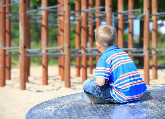 thoughtful child boy or kid on playground