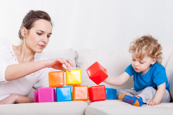 Mother and son playing blocks